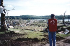 Red Cross Volunteer Jack Burns looks over the Devasted Green Acres Campground